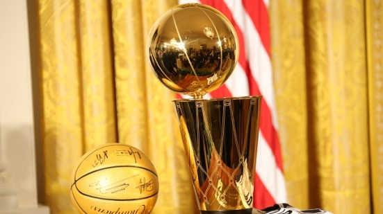 WASHINGTON, DC - JANUARY 12: A autograph basketball and the Larry O'Brien trophy displayed during a visit by the San Antonio Spurs to the White House to celebrate their 2014 NBA Championship on January 12, 2015 in Washington, DC. NOTE TO USER: User expressly acknowledges and agrees that, by downloading and or using this photograph, User is consenting to the terms and conditions of the Getty Images License Agreement. Mandatory Copyright Notice: Copyright 2015 NBAE (Photo by Ned Dishman/NBAE via Getty Images)